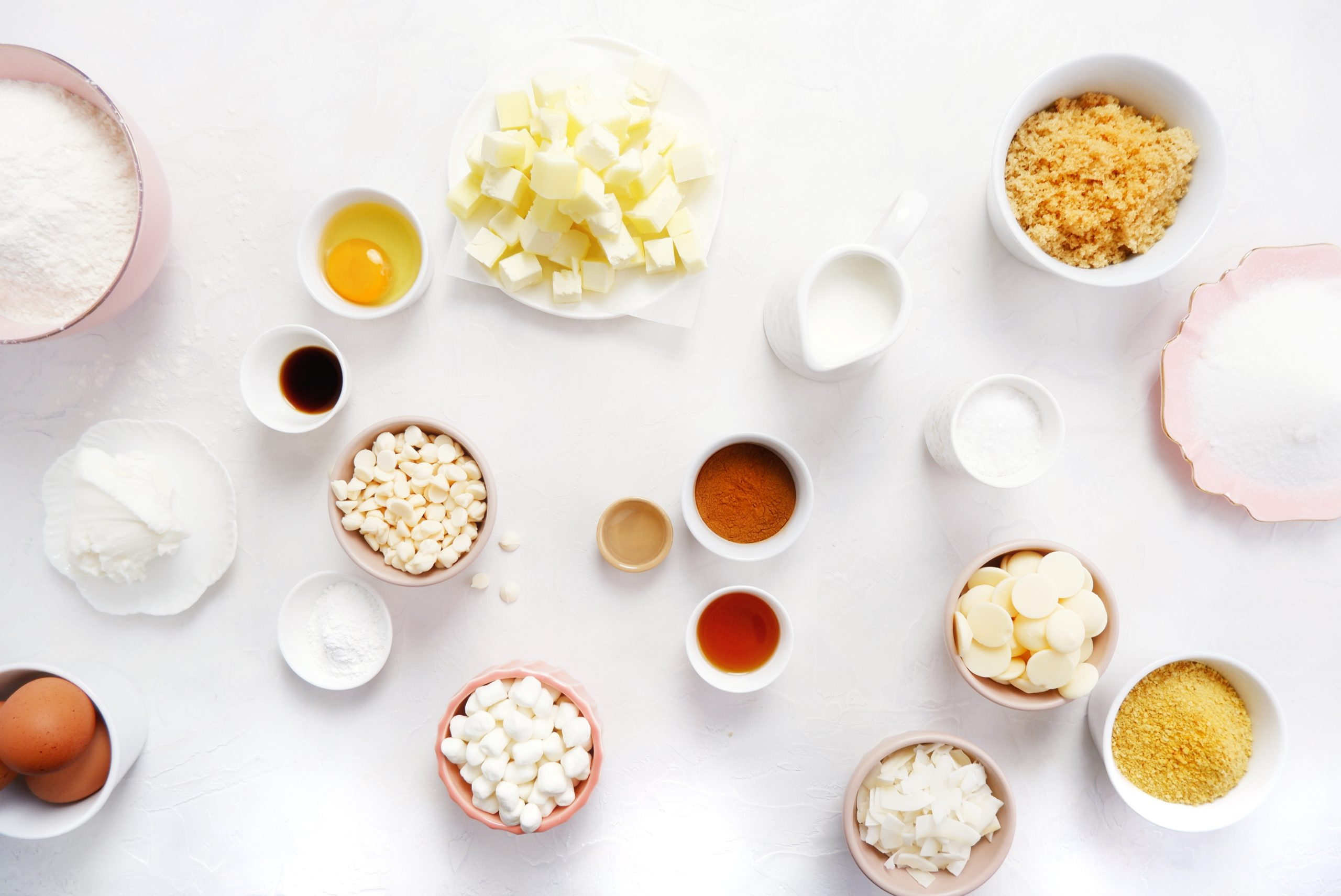 flour, sugar, butter, and other ingredients used in baking in bowls