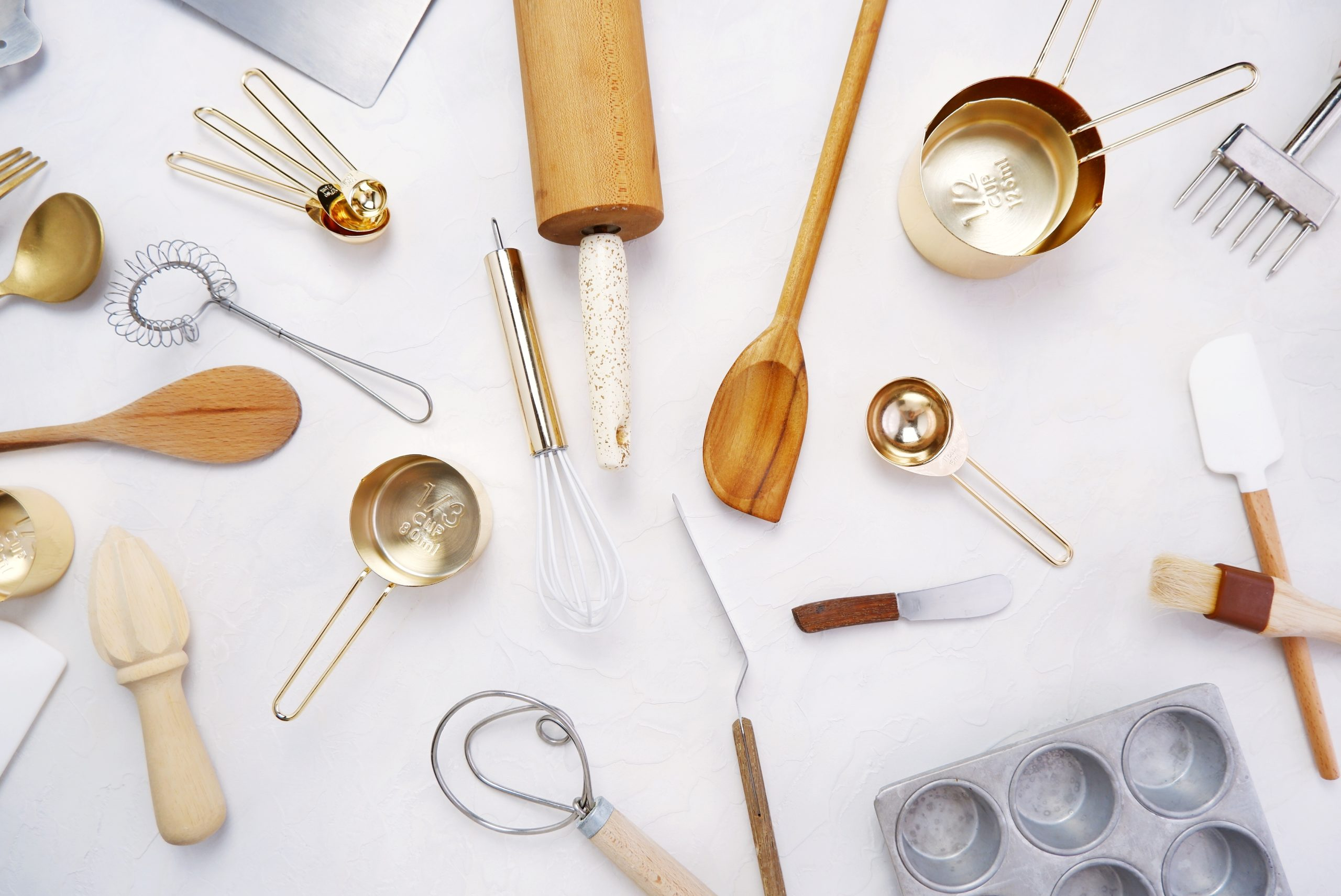 rolling pins, spatulas, pans and other tools used for baking