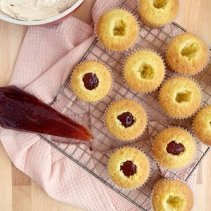 cupcakes being filled with jam
