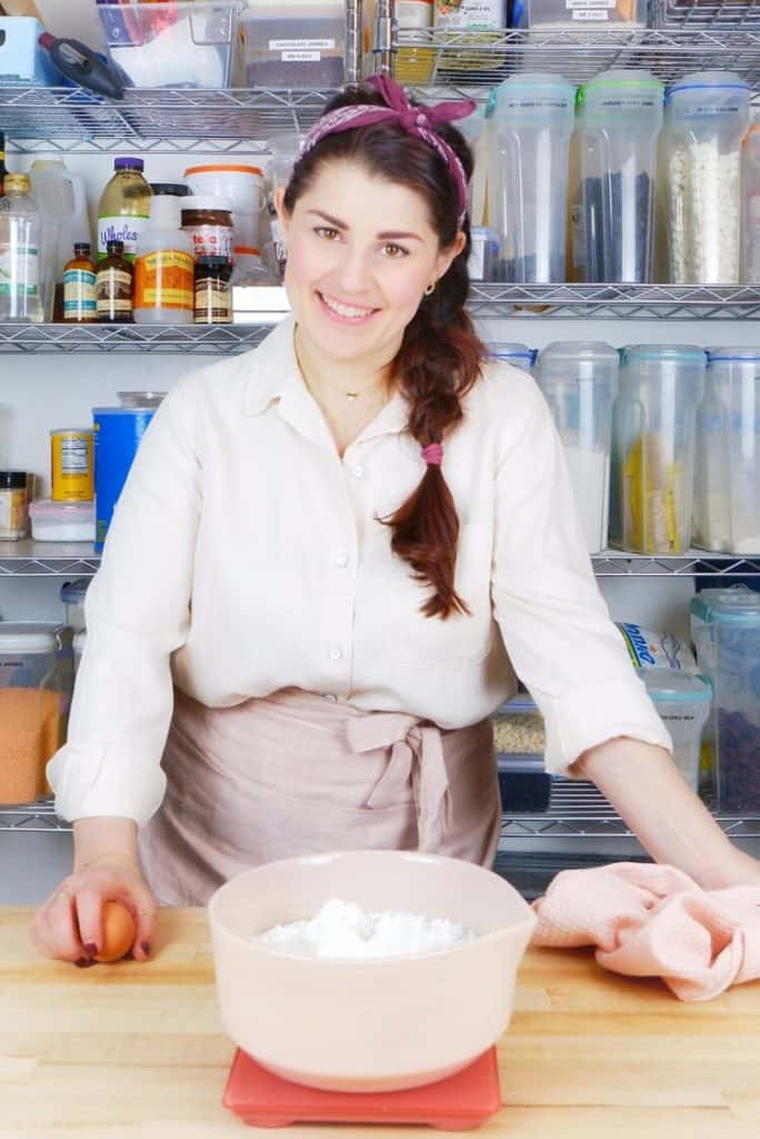 portrait of Jocelyn, the founder of MINT + MALLOW kitchen behind her work station in the bakery