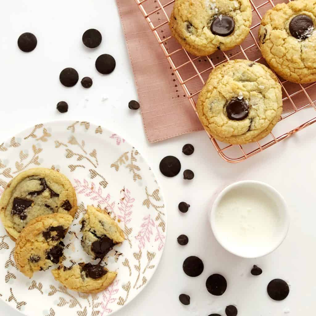 baked sea salt chocolate chunk cookies  on a plate and baking tray