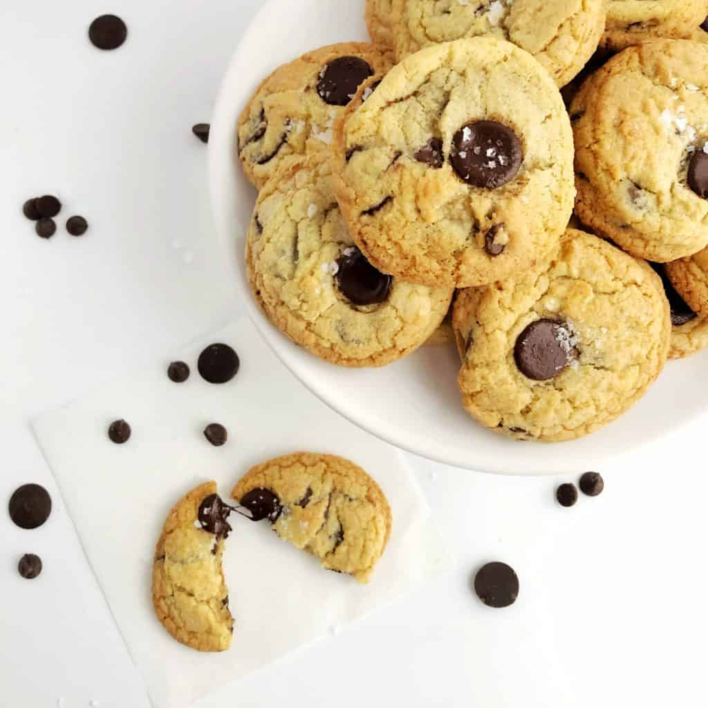 baked sea salt chocolate chip cookies on a plate