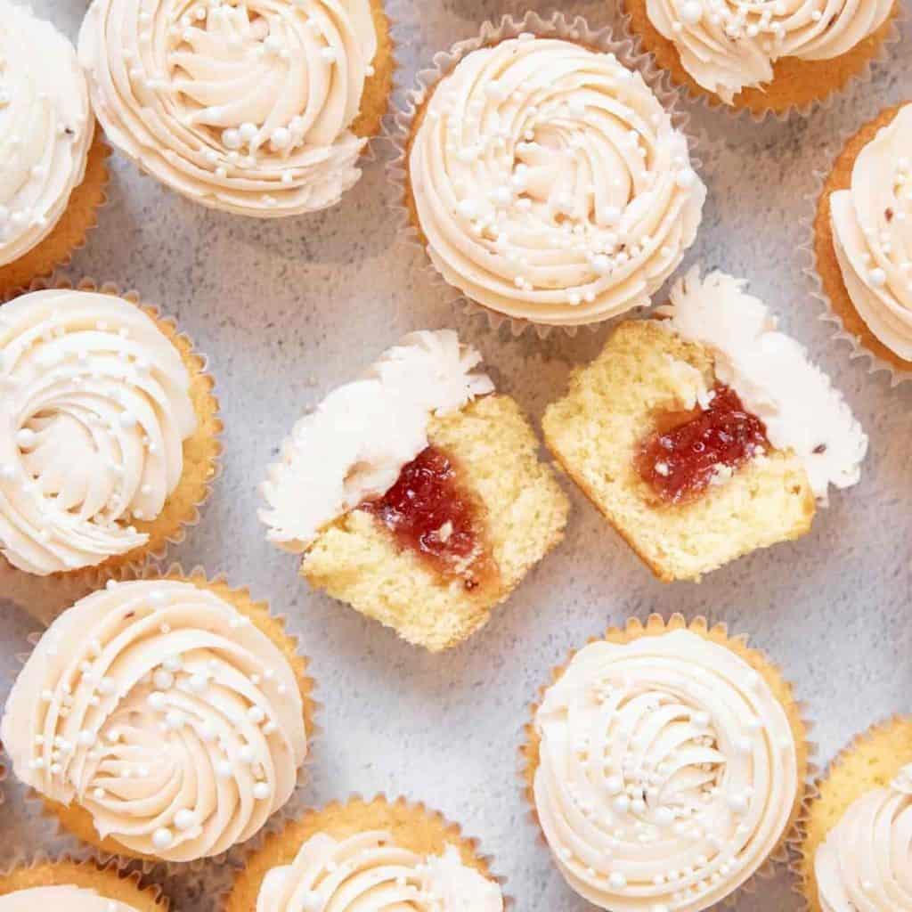 elderflower cupcakes with buttercream rosette ripped open with jam center
