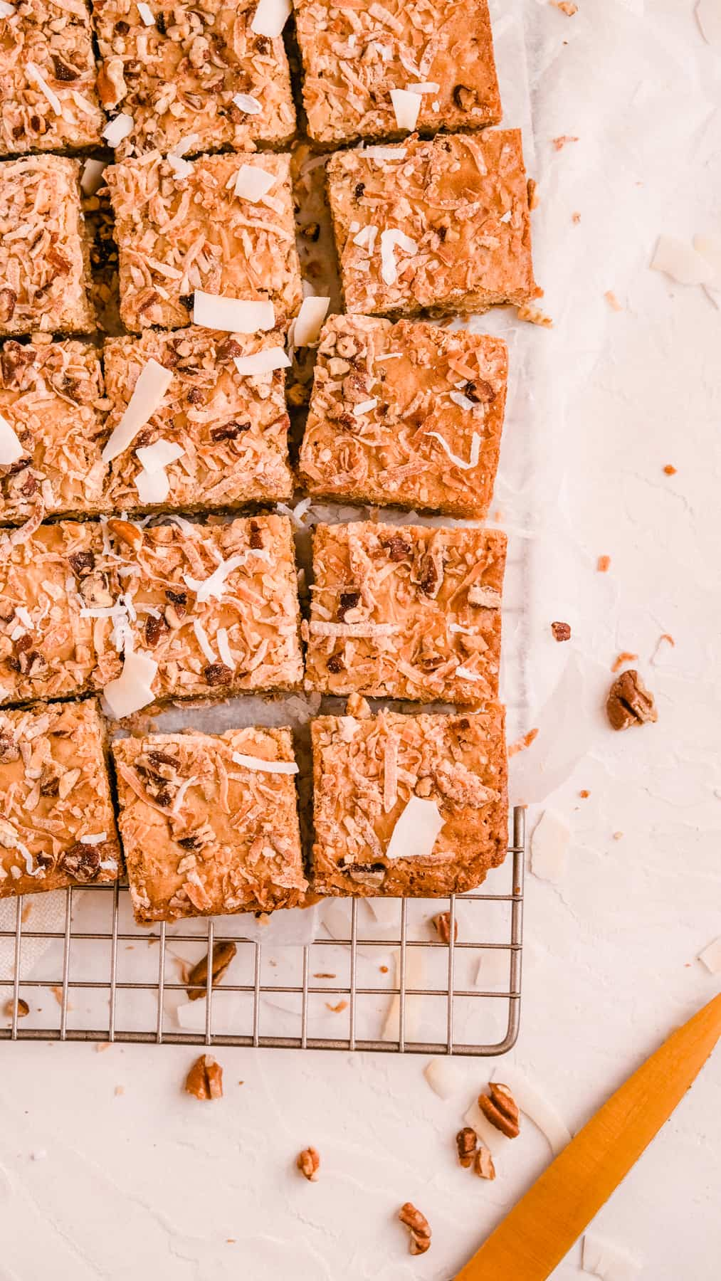 coconut butterscotch cookie bars on a wire rack