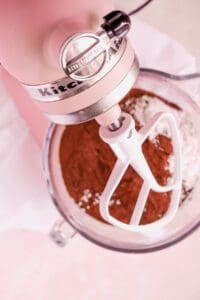 a bowl of chocolate buttercream frosting on a mixer