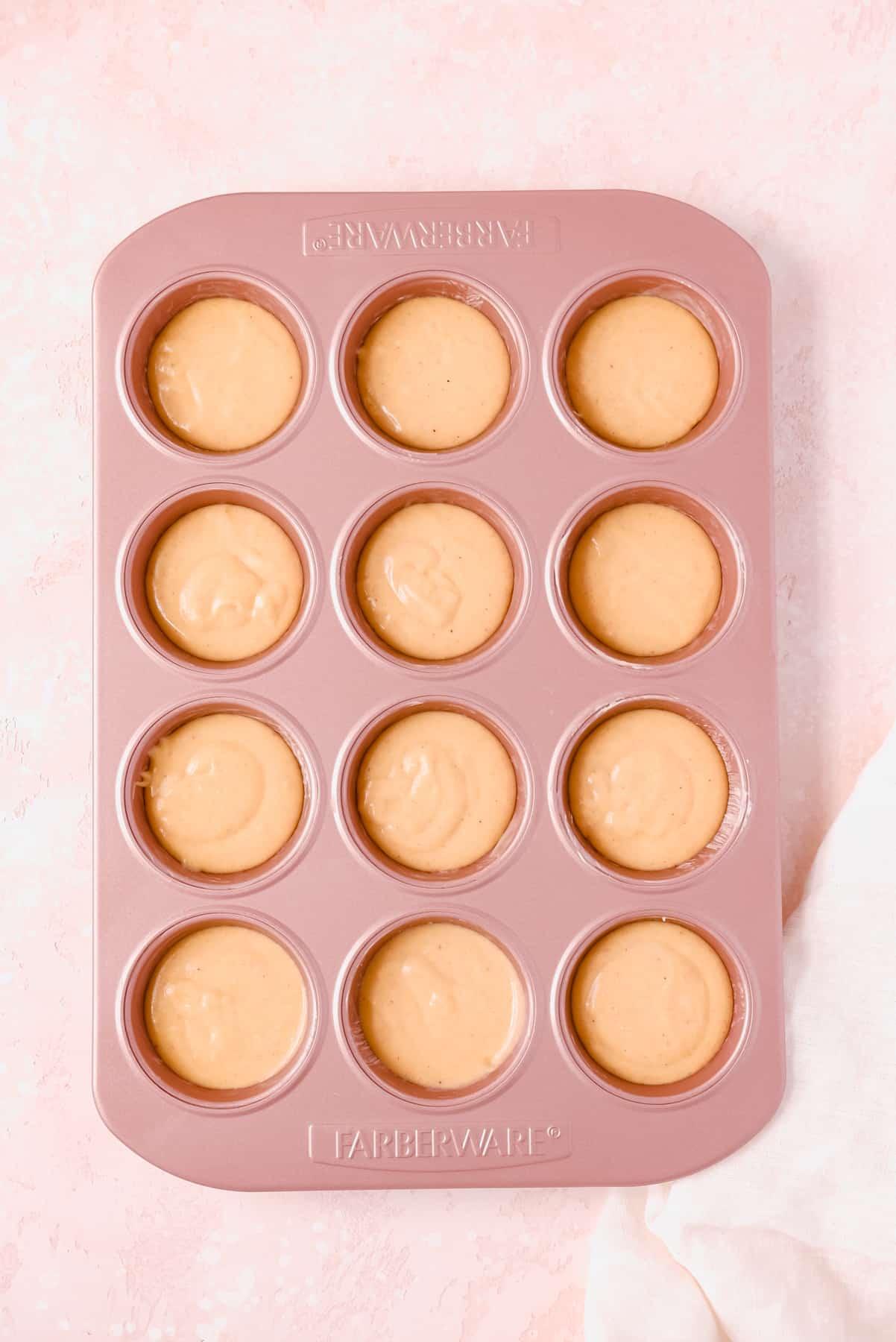 Cinnamon Donut Muffin batter in a pan