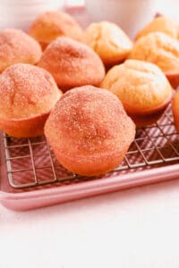 Cinnamon Donut Muffins on a cooling rack