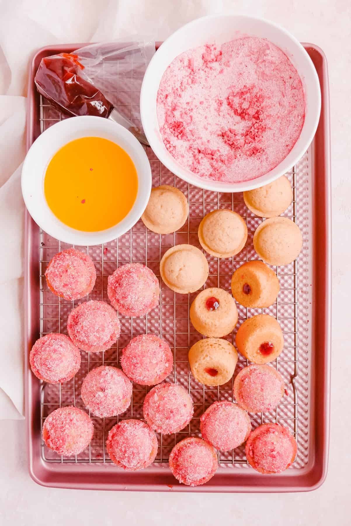 Strawberry Jam-Filled Donut Muffins on a cooling rack
