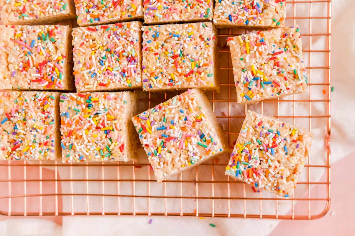 Brown Butter Rice Krispie Treats with sprinkles on top on a wire rack