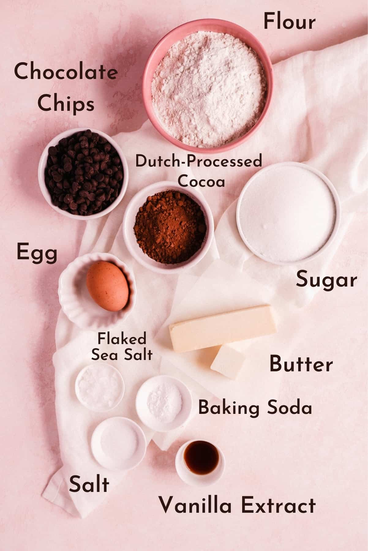 labeled ingredients for this recipe in their own bowls on a pink background