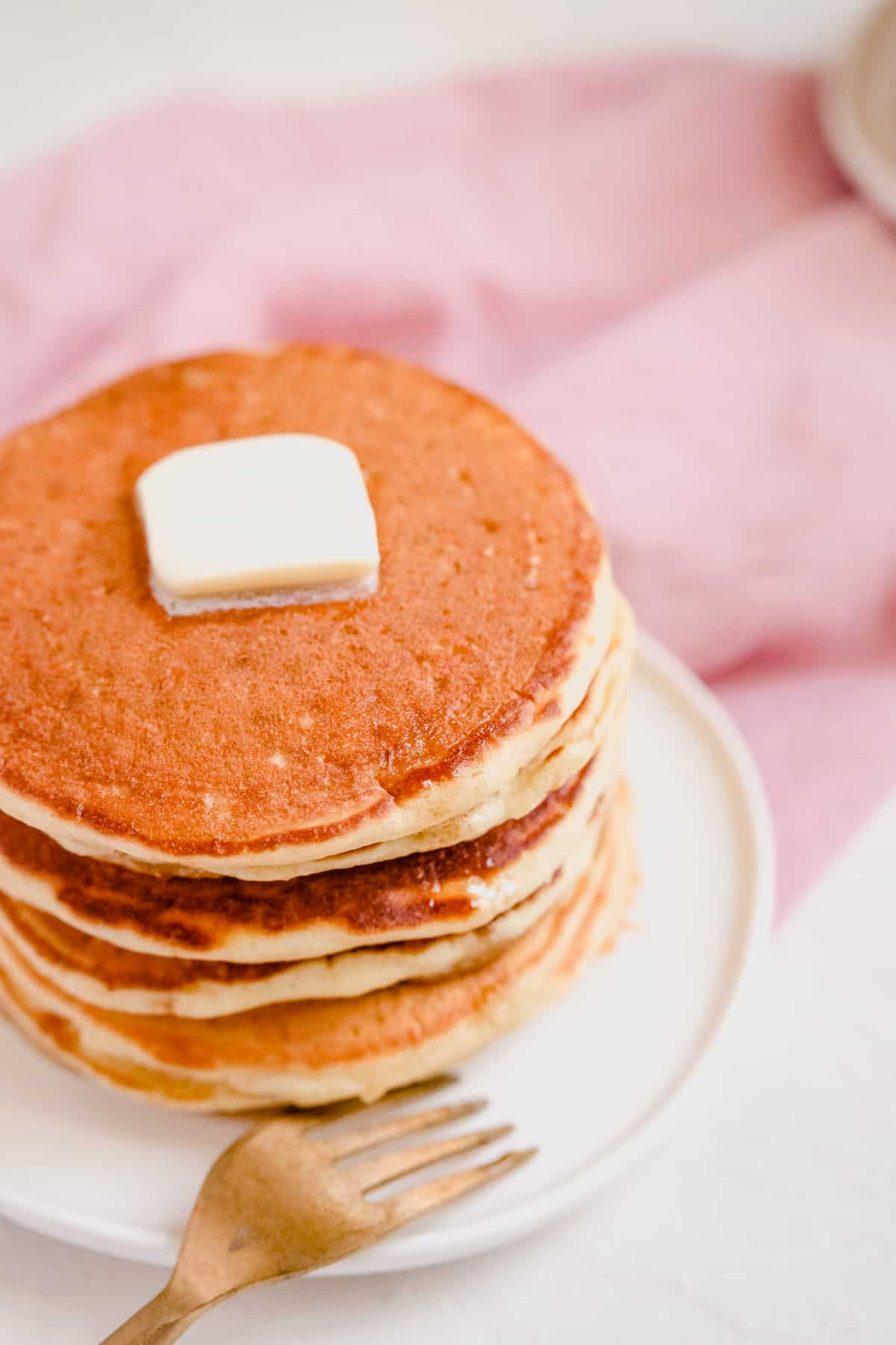 a stack of buttermilk pancakes with butter