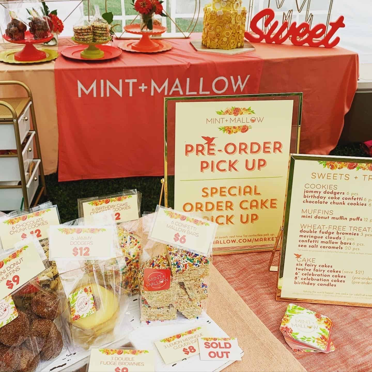 market menu and ordering signs with bags of cookies, muffins and bars