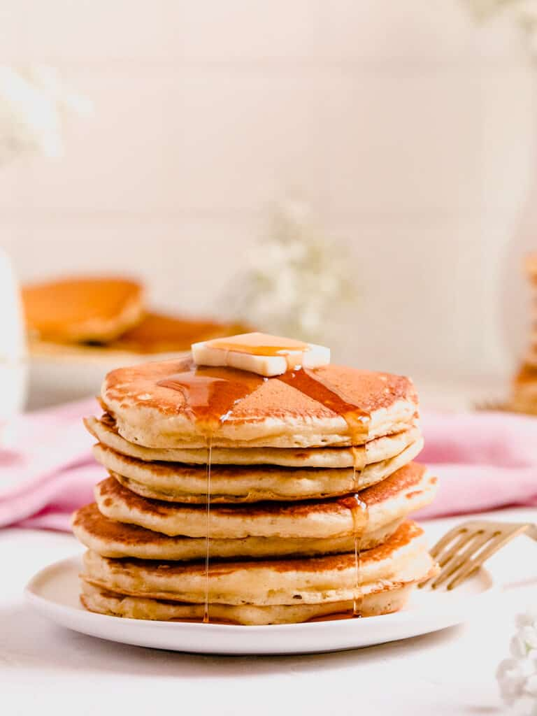 Fluffy Buttermilk Pancakes with butter and syrup on a small plate