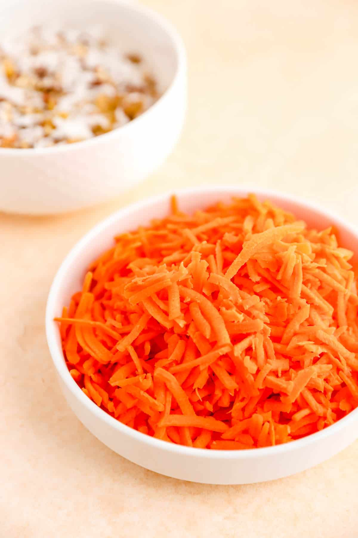 shredded carrot in a small white dish.