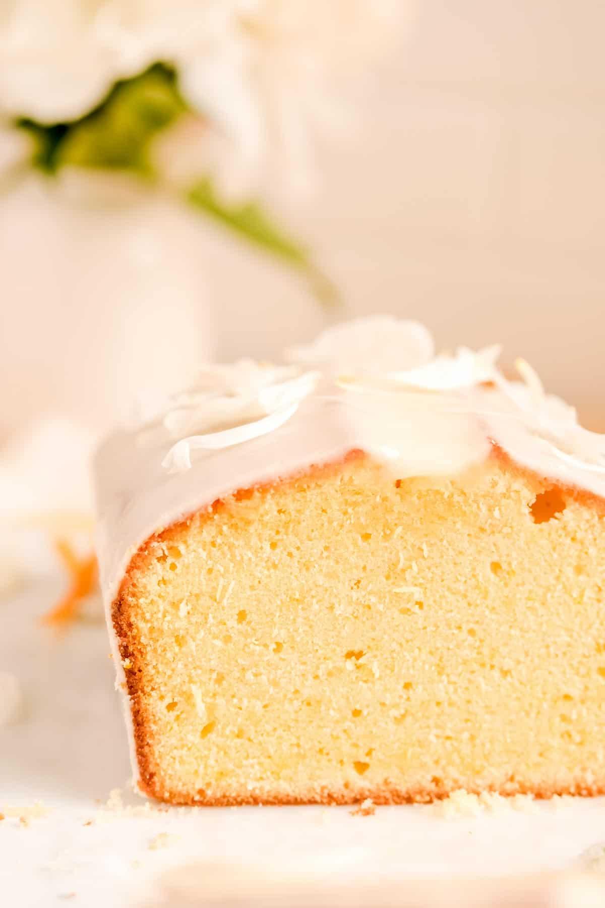 close up of sliced glazed citrus cream cheese pound cake.