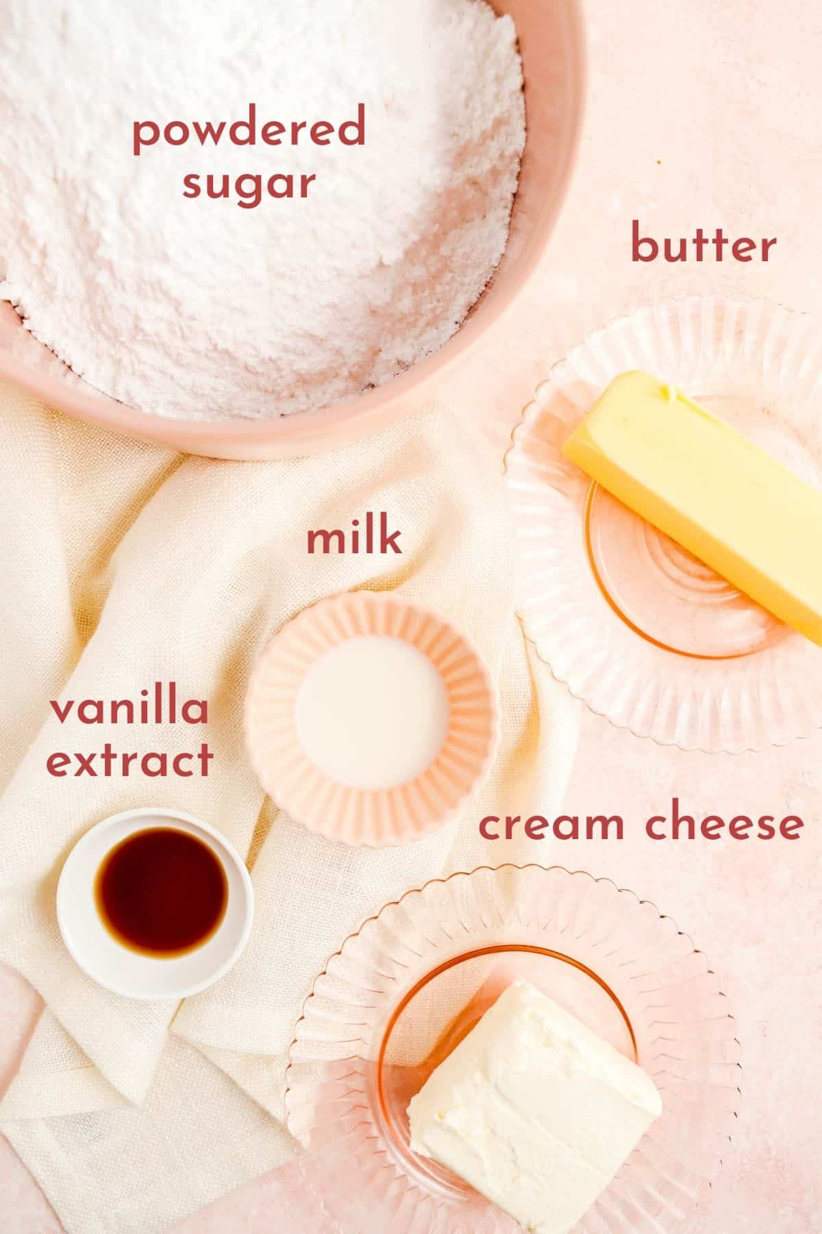 ingredients in bowls and on plates to make cream cheese frosting without heavy cream.