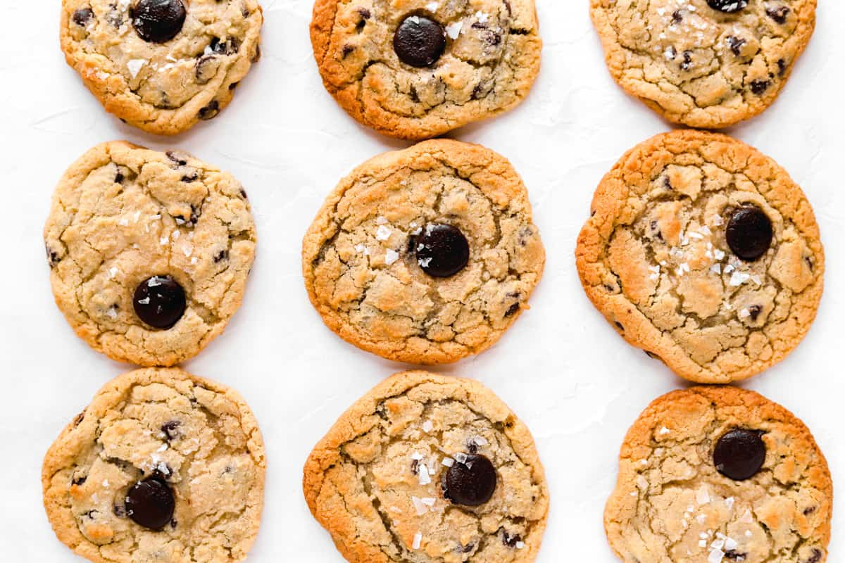 close up of 9 chocolate chip cookies baked using different baking settings