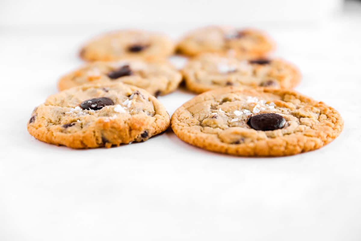 a side-view of chocolate chips cookies with a thicker one baked on convection settings
