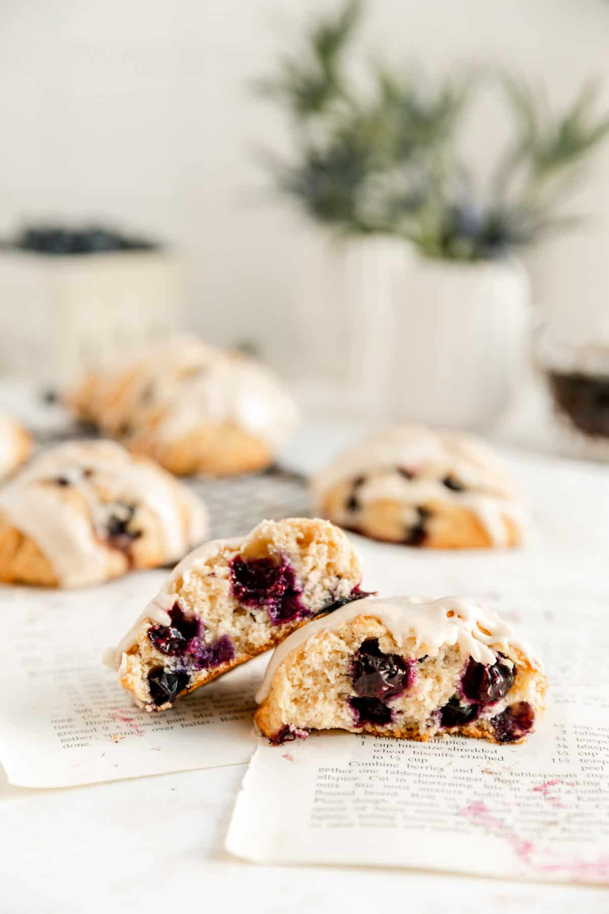 two stacked scone halves showing the inside filled with blueberries on recipe pages