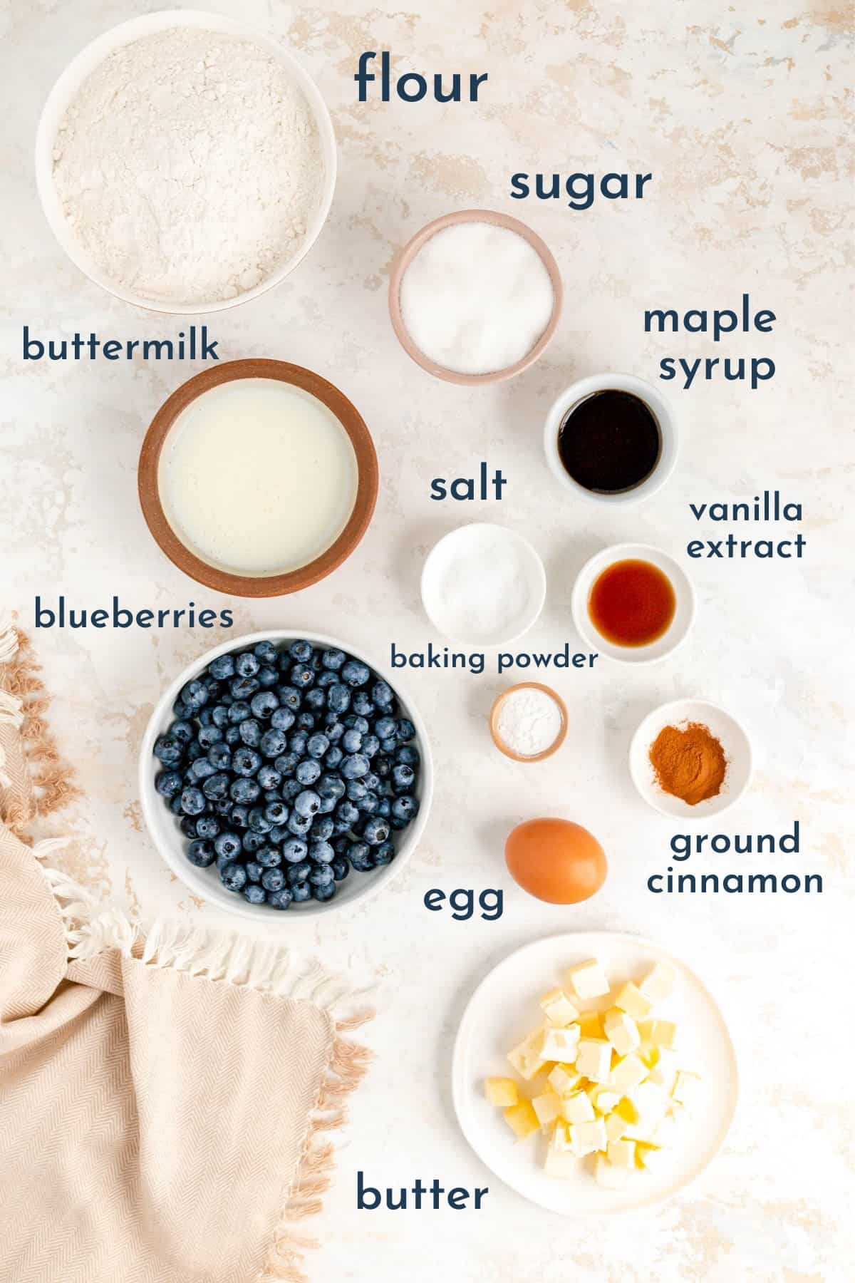 labeled bowls of ingredients for making maple blueberry drop scones